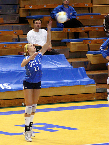 Volleyball floater serve techniques: UCLA player serving the ball