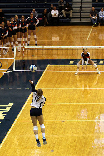 To forearm pass a volleyball you clasps both arms together at the wrists, usually one palm of the hand inside the other while contacting the ball on the forearms (Richard Yuan)