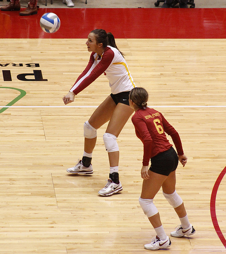 How to pass a volleyball. This forces you to keep both of your elbows straight and will help you maintain a flat platform or flat surface when you contact the ball. (Matt Van Winkle)