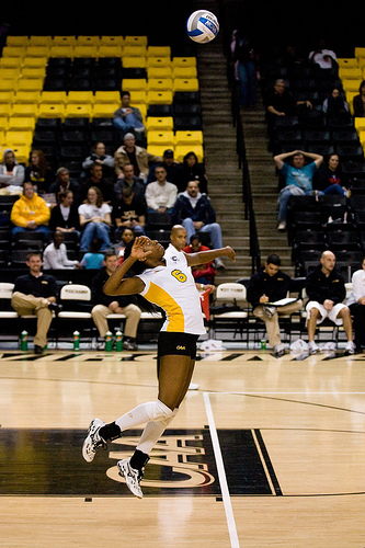 Dimensions of a Volleyball Court: Player Serving Behind The White Service Line (photo Henry Stern)