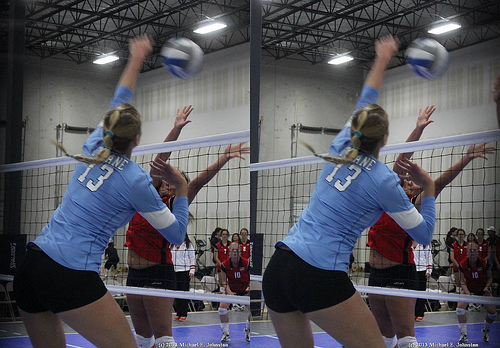 Volleyball Terms Spiking: Left handed spiker hitting a line shot. (Michael E Johnston)