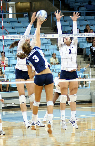 Three Volleyball Attack Skills Outside Hitters Use: Villanova hitter aims for the seam, the hole in the block between the two Chapel Hill blockers.