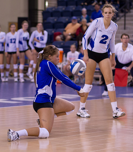 The dig volleyball skill is used by a digger who uses their forearms to create a platform to deflect an attack hit in the air to keep it off the court floor.