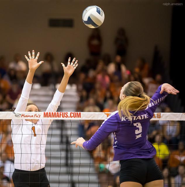 Kansas State volleyball hitter keeps elbow high to hit against the Texas block (Ralph Arvesen)