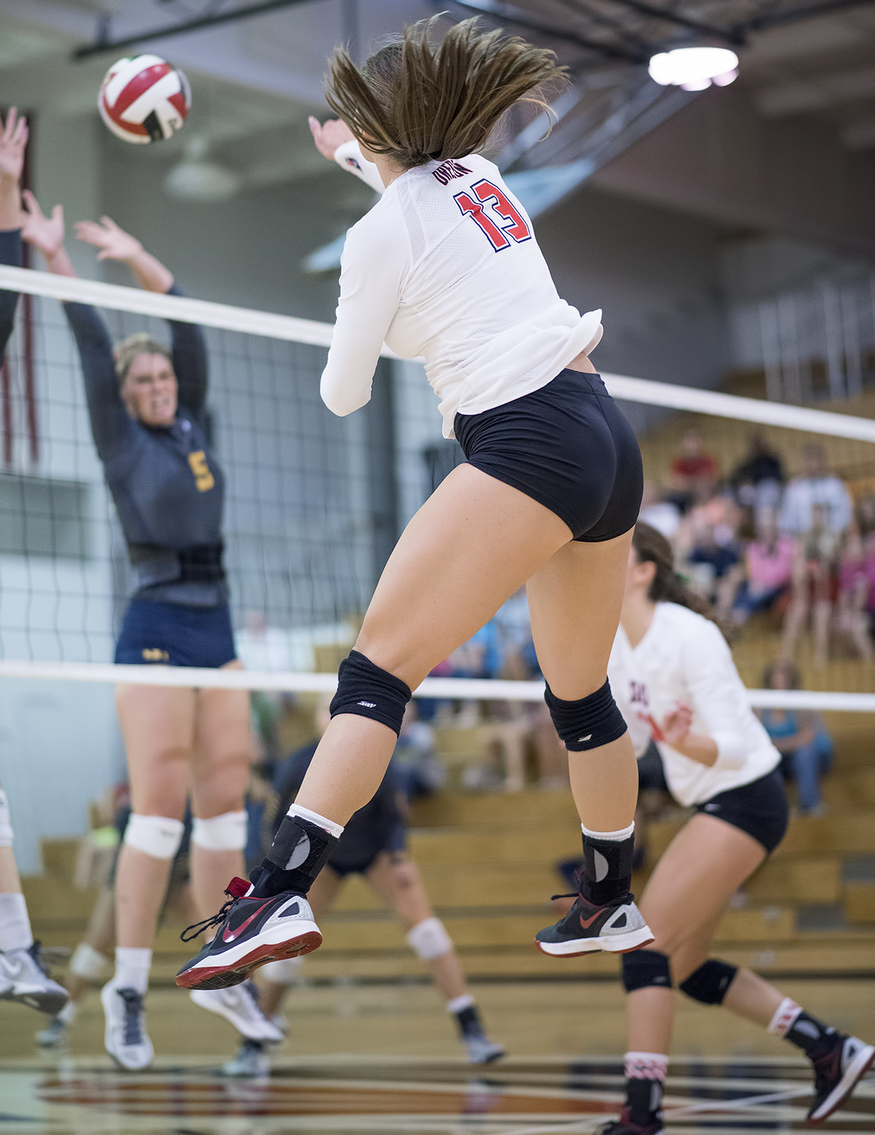 How To Spike in Volleyball: The outside hitter is the left side spiker in volleyball at the net who is the team's offensive weapon who usually gets the most sets. (Al Case)