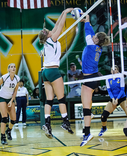 Tips on Volleyball: A joust is when both a blocker and a hitter contact the ball when its above the net, at the same time.   (CE Andersen photo)
