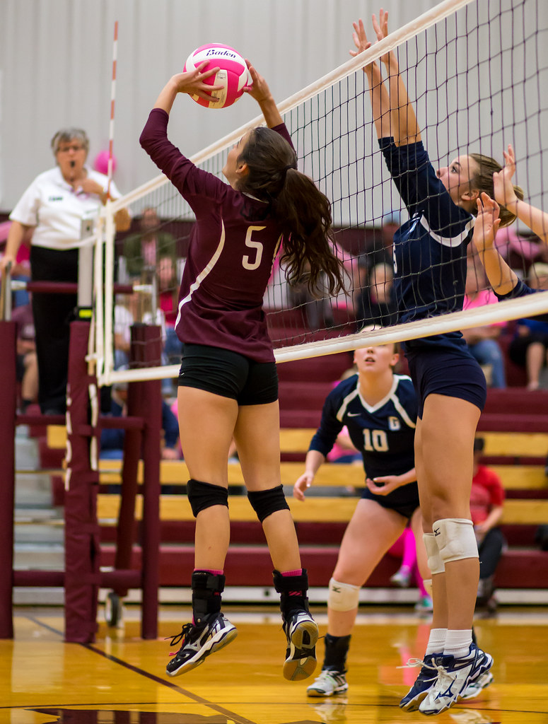 Volleyball Position: The setter's job is to outsmart the opposing team's block so her hitters hit the ball with the least number of opposing blockers trying to block their attack hits. (Ralph Aversen)