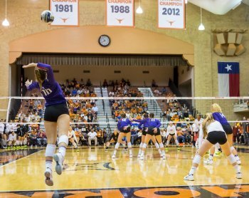 The Jump volleyball serve starts with a toss 6 - 8 feet in the air followed by a 3-4 step spike approach used to launch the server in the air before contacting the ball. (Ralph Arvesen)