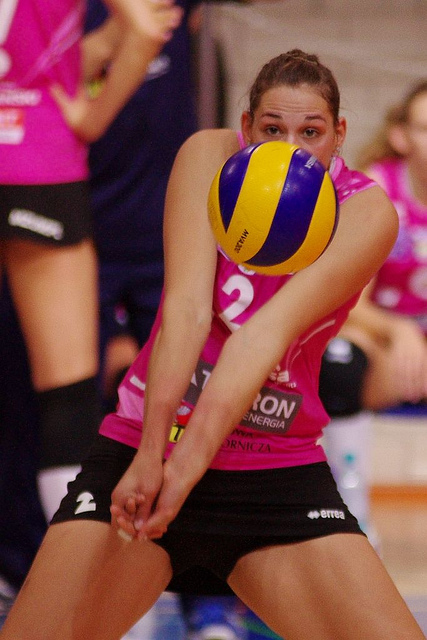 The volleyball ready position for passing keeps thumbs and wrists together to contact a ball on the forearms to send it to another player usually the setter or over the net.  (Jaroslaw Popczyk)