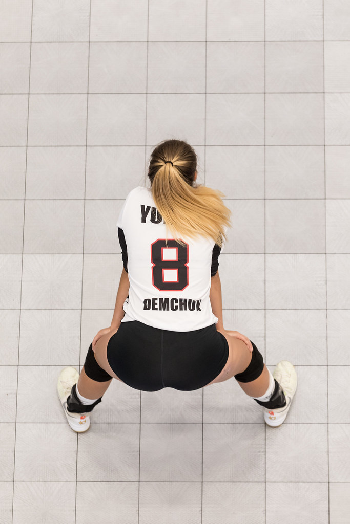 Volleyball Ready Position For Passing: You have your hands on your knees while the server is bouncing the ball and going through their pre-serve routine.  (Matt Duboff)