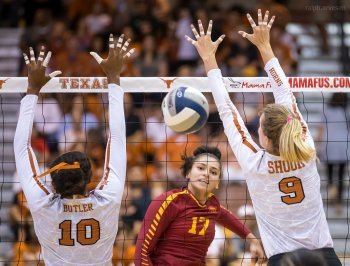 Volleyball Plays: Texas middle blocker Brionne Butler is late getting to the outside to close the block with setter Ashley Shook. (Ralph Arvesen)