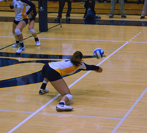 Cal State Bears off side blocker digs the tip attack hit from the opposing team which is aimed to land behind her blockers. (RRaiderstyle)