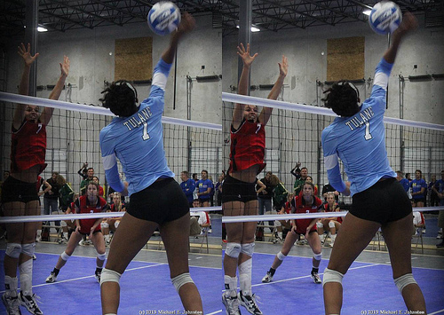 Tulane outside hitter attacking against one block.