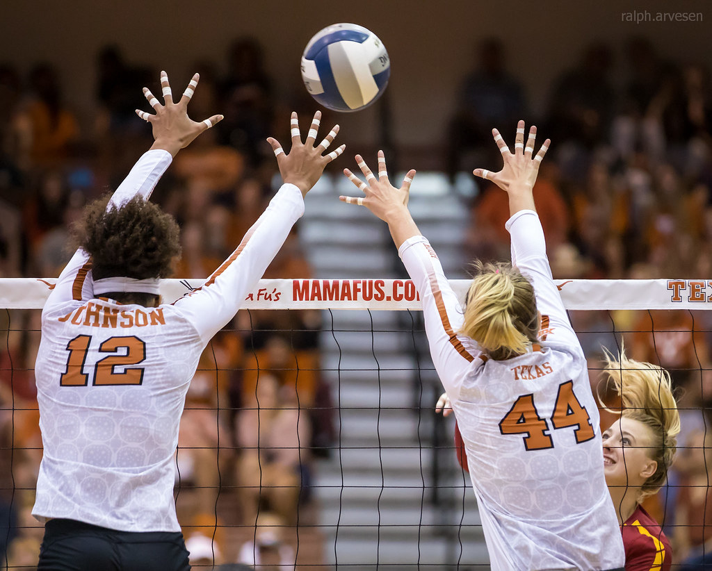 Texas Longhorns volleyball blocking technique watch them closing the seam of the block while keeping hips and shoulders parallel to the net. (Ralph Arvesan photo)