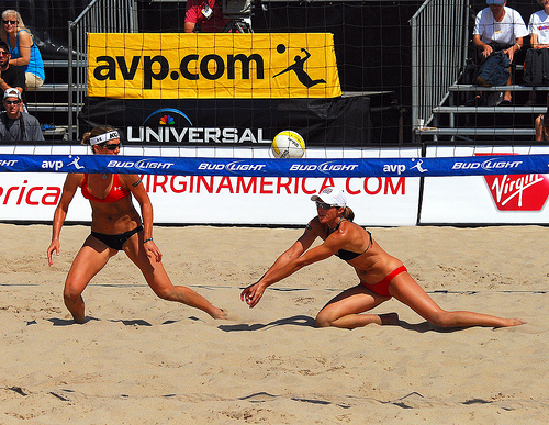 With a ball coming hard and fast between two beach passers, the teammates have to communicate quickly to decide who is going to move to pass that deep ball. (Steve Corey)