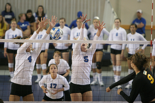 Volleyball block tips:Creighton Bluejays outside blocker blocks with arms angled back into the middle of the opposing team's court Photo by White and Blue Review