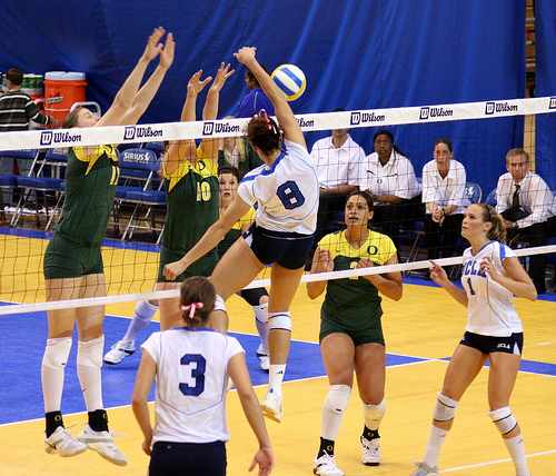Youth middle blockers should take one area of the court away when blocking so the defensive players in the backrow know exactly where to be behind them. (JMR Photography)