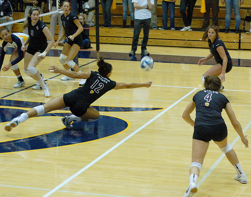 The Cal Berkeley hitter tipped the ball to the middle of the court over the Arizona State double block while the A State off side blocker attempts to dig the ball in defense.(RRaiderstyle)
