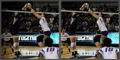 East Carolina vs. Rice In A Blocking Volleyball Joust At The Net. A joust occurs when two players contact the ball over the net at the same time. (Michael E. Johnston)