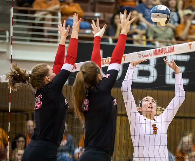 Volleyball Vocabulary: If the setter can make the opposing middle  think she's going to set middle, then the middle blocker has to stay and block the middle. (Ralph Arvesen)