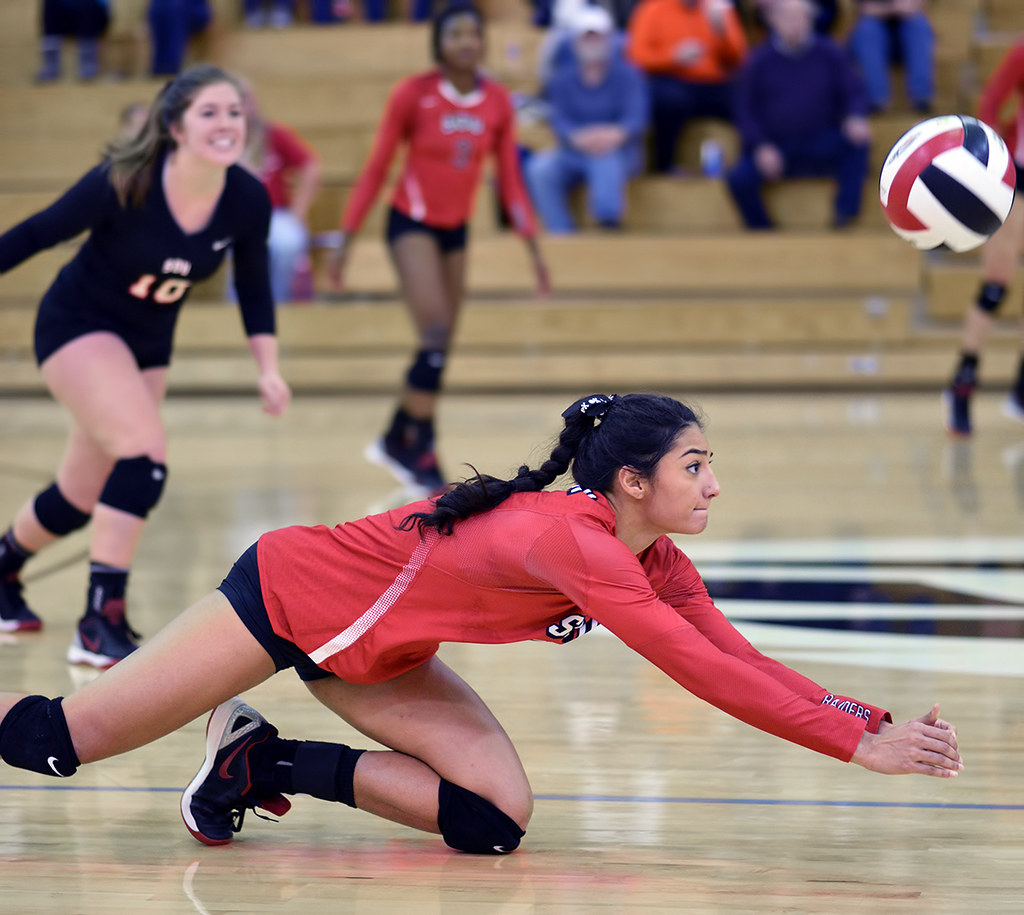 Volleyball Digging: How you stop a hard hit spike or attack hit ball by placing your platformed arms in the path of the ball to deflect it in the air to keep it from hitting your floor.(Al Case)