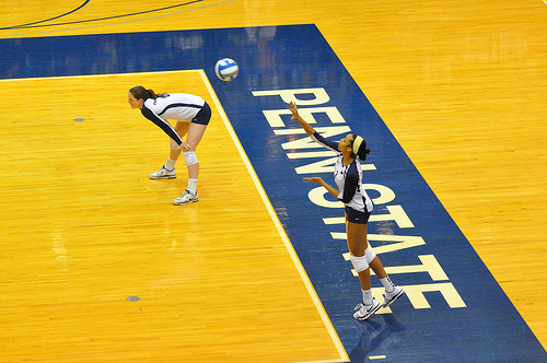 Volleyball Serves: The overhand serve in volleyball requires you to toss the ball higher in the air before contacting it with an open hand above your head. (John O'Brien)