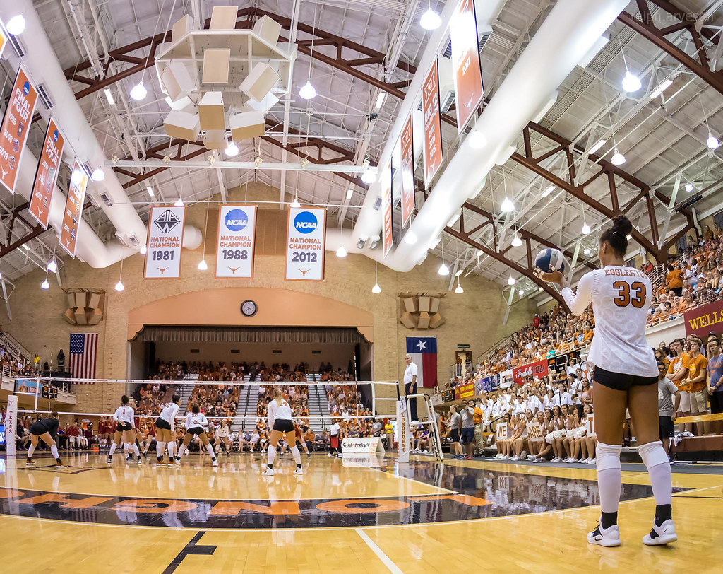 One of the sneakiest volleyball serve tactics to use is to serve the ball short to the players in the front row. (Ralph Aversen)