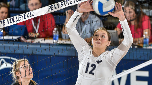 The Middle Volleyball Blocker: Penn State setter Micha Hancock (12) is watched by Iowa Hawkeyes middle blocker in match against Iowa at Rec Hall. (Photo by Mark Selders)