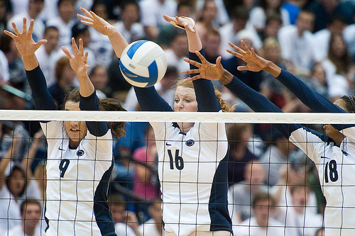 The Middle Volleyball Blocker: Blair Brown (left) and middle volleyball blocker Katie Slay and Deja McClendon, both freshmen fors a triple block against GWU on Friday, Sept. 17.(Penn State News)