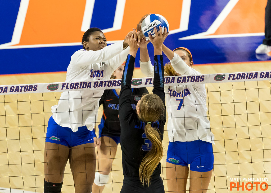 Florida Gators blocking the overpass with a joust against the opposing team's setter (Matt Pendleton photo)