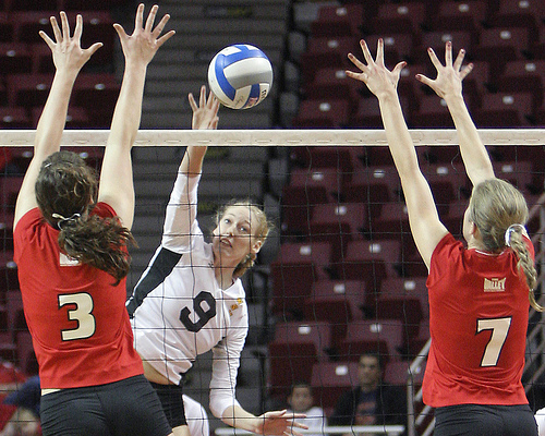 One Volleyball Attack Tactic Outside Hitters Use: Illinois State Redbirds volleyball hitter attacks against a double block. (Bill Shaner)