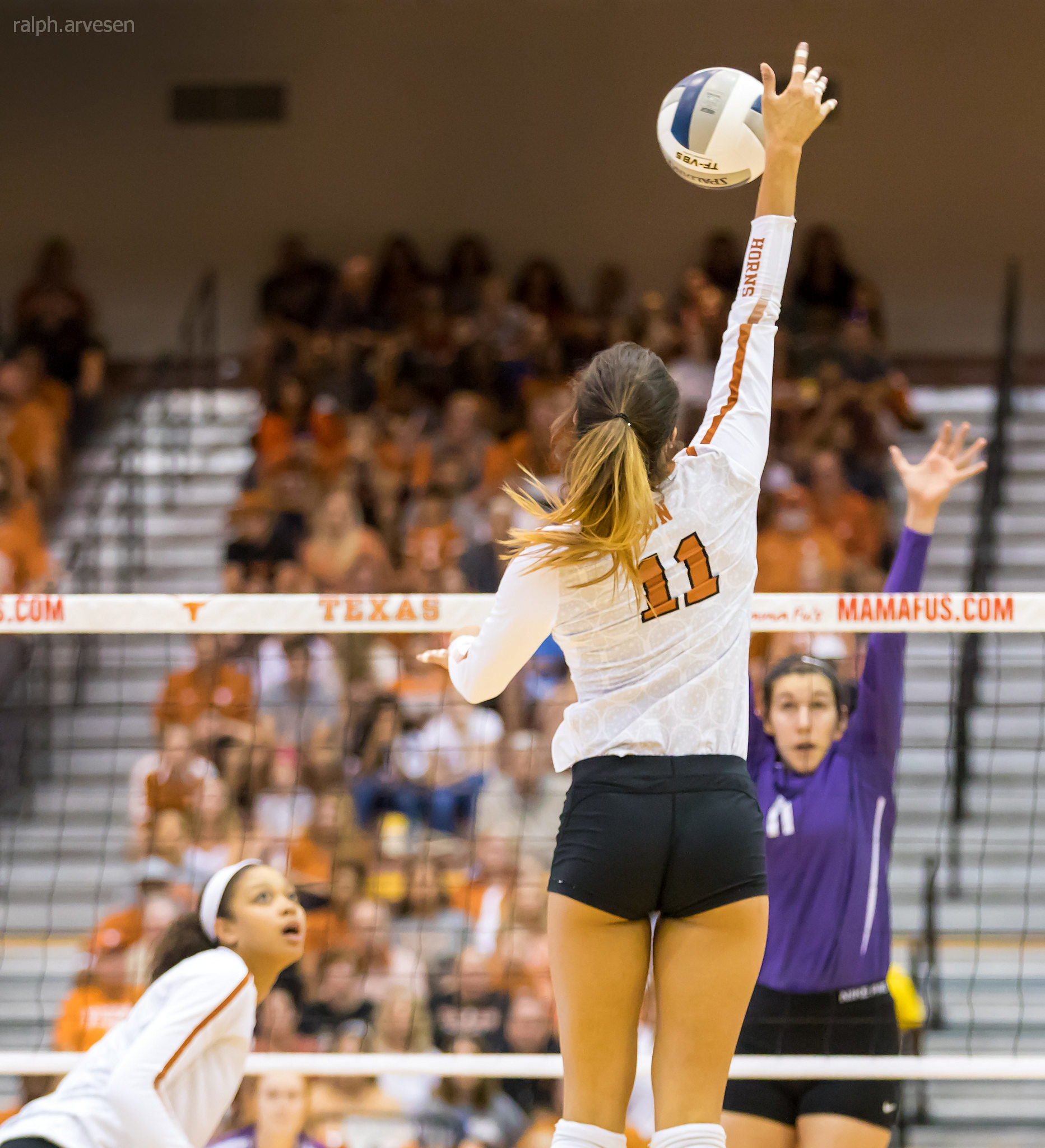 Volleyball Approach: When you take a good aggressive approach, make contact with the ball at its highest point and swing fast and high contacting the ball at its 12 noon point. (Ralph Arvesen)