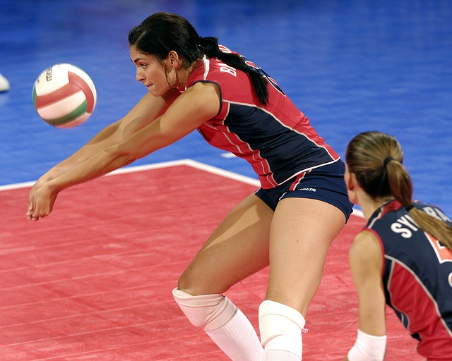 Fundamental skills of volleyball. Clasp both thumbs and hold wrists together creating a flat platform to forearm pass the volleyball in the air deflecting it to a player or over the net.