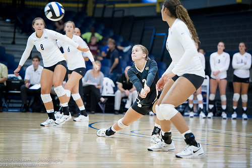 Volleyball bump: Whether its one side step or one lateral shuffle step away from you to your right or left side you want to beat the ball to THAT spot. (Mark Shaiken photo)