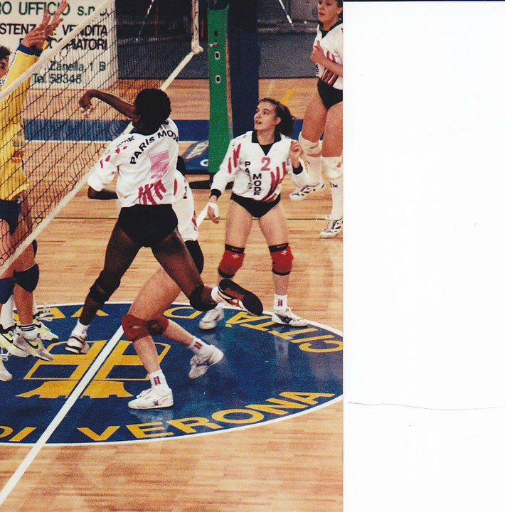 Volleyball Game Rules: Coach April, pro volleyball player in Italy, attacking during a rally.