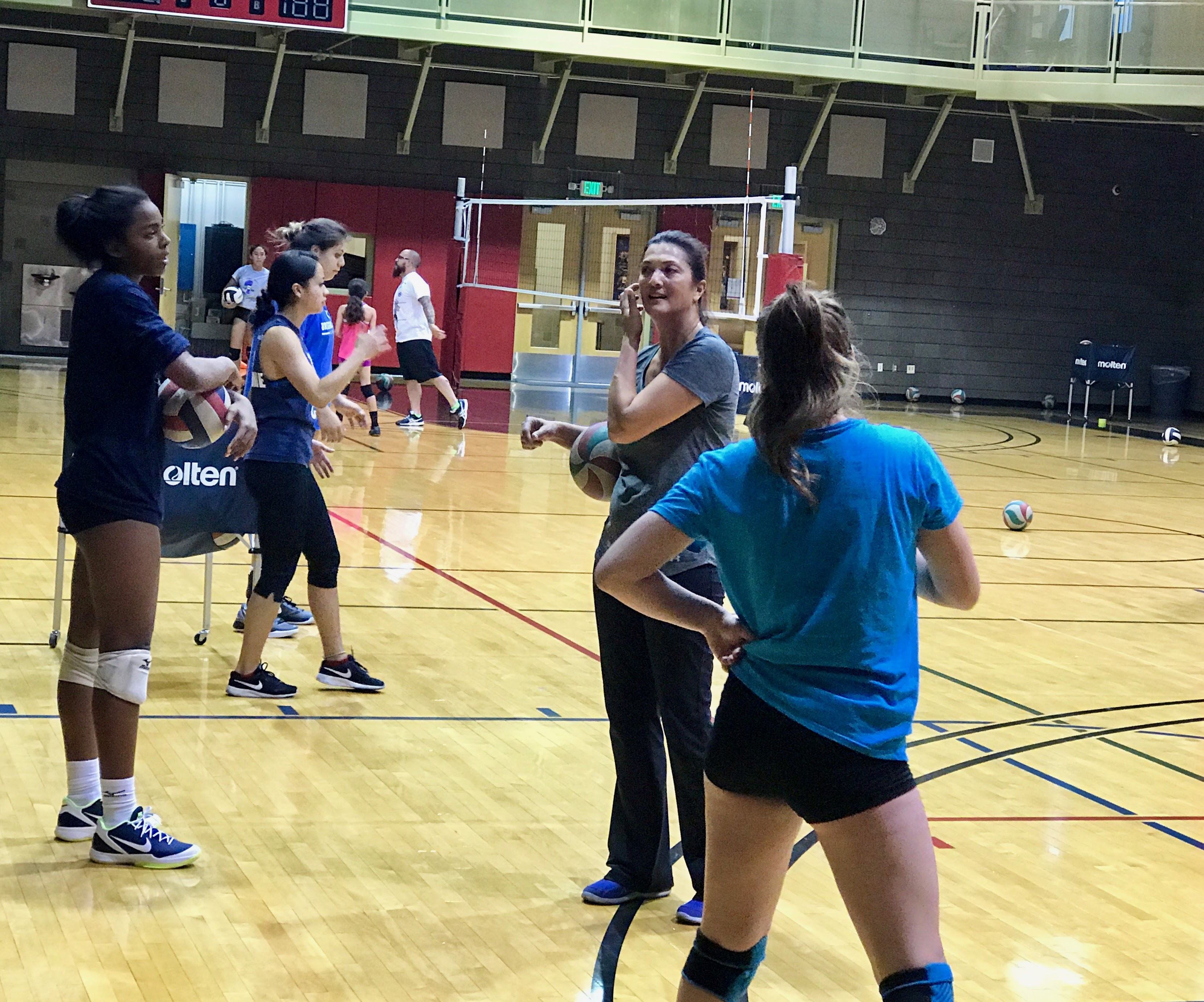 Former teammate indoor Olympian, world beach champion and two-time US Olympic beach volleyball coach Liz Masakayan at Stupak visiting a Boot Camp class.