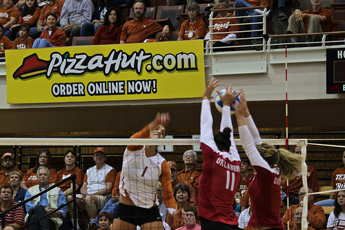 Volleyball Block Technique: Blockers should go up and penetrate the plane of the net with angled hands and arms that deflect the ball to the middle of the opposing court. (Aaron Vazquez)