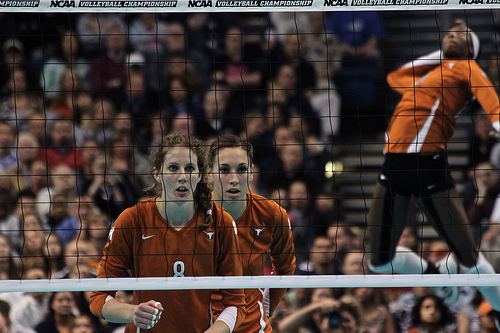 Indoor volleyball court:Olympian and Texas Longhorn Volleyball Player, Destinee Hooker Jump Serving From Behind Zone 5 photo by Aaron Vazquez