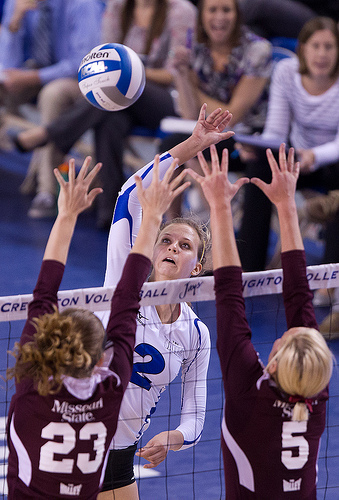Volleyball definition: Missouri State double block closes down the line on opposing hitter, forcing her to hit cross court.