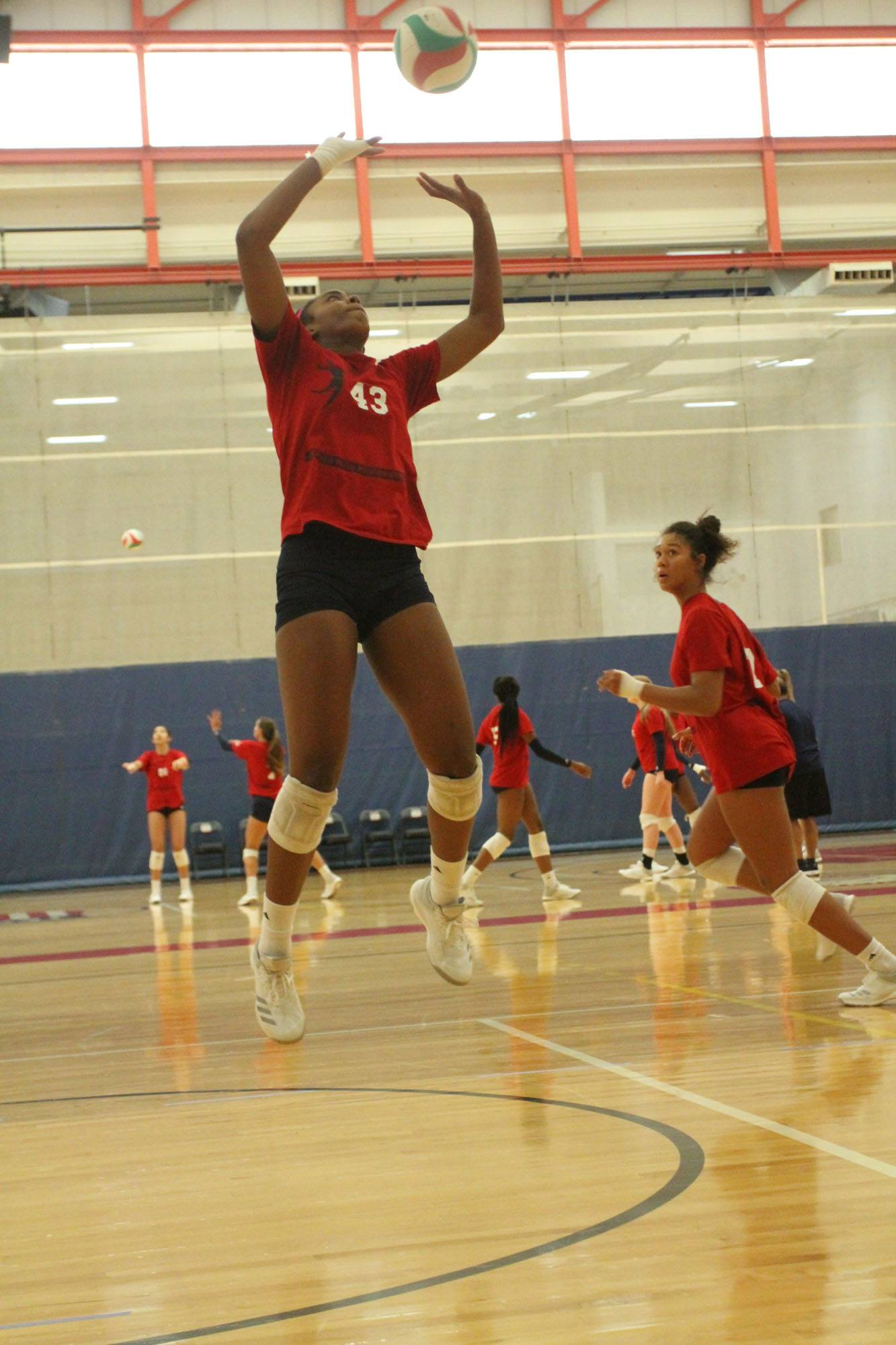 As a setter in volleyball you want to quickly bring both arms up in front of you and as your arms come up, bring them closer together. (USA Volleyball)