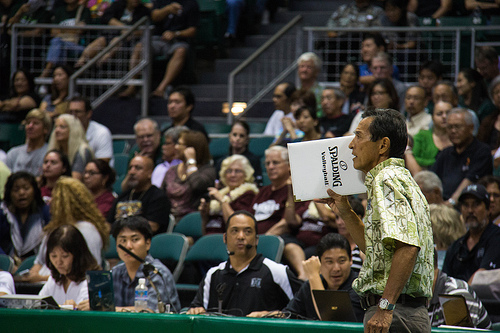 Hawaii Coach Dave Shoji communicates to his server what volleyball court zone he wants her to serve to. (Abercrombie)