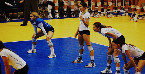 Indoor volleyball court:UCLA Passers In Volleyball Serve Receive Waiting For The Opposing Team To Serve The Ball photo by JMR Photography