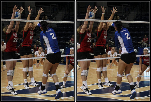 Arkansas State Blocker in Volleyball Closes Down The Line Against Air Force Attacker Photo by Michael E. Johnston
