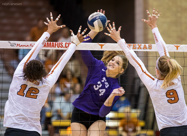 TCU outside hitter attacks against the Texas double block (Ralph Iversen)