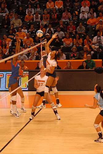 Volleyball Players Set: Tennessee middle blocker hitting a one set in the middle