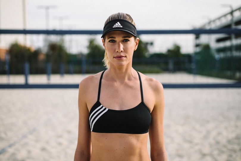 Pro beach Volleyball player and 2020 Tokyo Olympic hopeful Alix Klineman wears Adidas volleyball uniforms for beach players during competition.