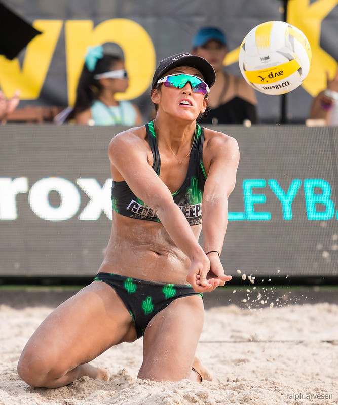 Geena Urango Bump Set in Volleyball: When girls first start playing beach volleyball, inevitably they get whistled for double hits and lifts when they try hand setting the ball. (Ralph Aversen)
