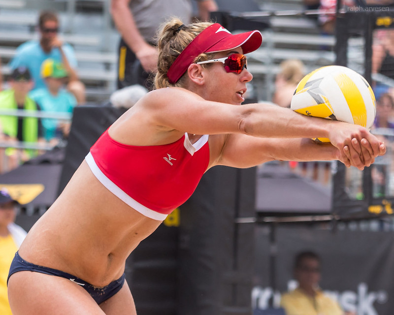 Beach Volleyball Passing Tips: You want to first run to get to the ball and then fight to get your feet in a balanced position underneath you so that you can have your body behind the ball. (Aversen)