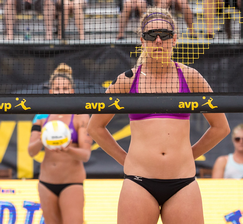 Beach volleyball hand signals are made by holding up their fingers behind the back of the player who is blocking at the net, or who is on the service line so the opposing team can't see. (Aversen)