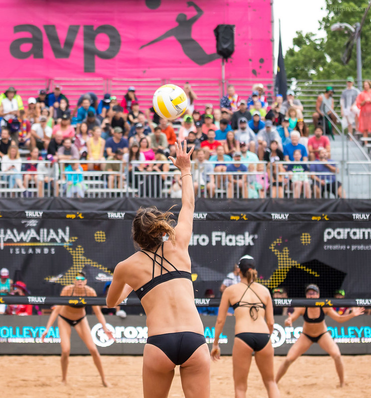 The beach volleyball ready position pro players use has their arms extended in front of them  elbows bent at 45 degree angle with palms of the hands facing upwards towards the sky. (Aversen)